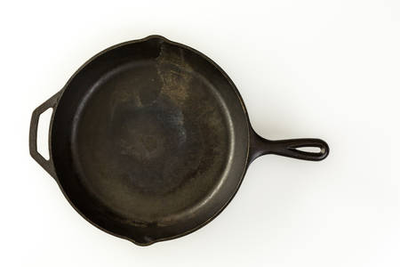 skillet: traditional cast iron skillet on a white background.