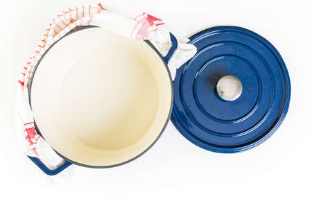 enameled: Enameled blue cast iron covered dutch oven on a white background.