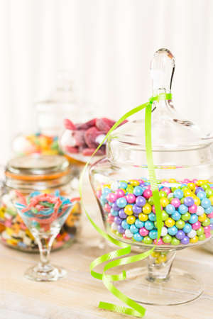 multicolored: Multicolored candies in glass candy jars. Stock Photo