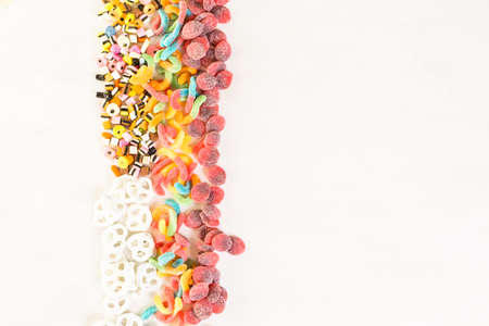 multicolored: Multicolored candies on a white table. Stock Photo