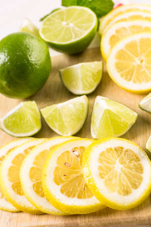 Variety of citrus fruit including lemons and limes.
