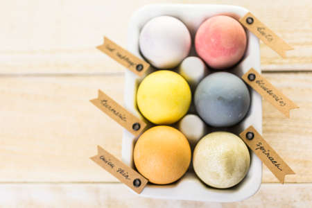 Easter eggs painted with natural egg dye from fruits and vegetables. Stock Photo