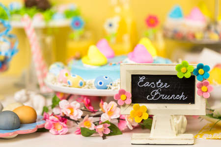 pastrie: Dessert table with Easter cake decorated with traditional Easter Peeps.