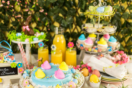 Dessert table with Easter cake decorated with traditional Easter Peeps.