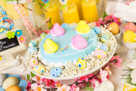 oj: Dessert table with Easter cake decorated with traditional Easter Peeps.