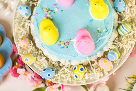 pastrie: Dessert table with Easter cake decorated with traditional Easter marshmallow chicks.