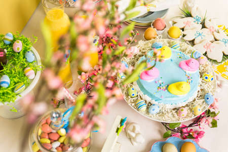 oj: Dessert table with Easter cake decorated with traditional Easter marshmallow chicks.