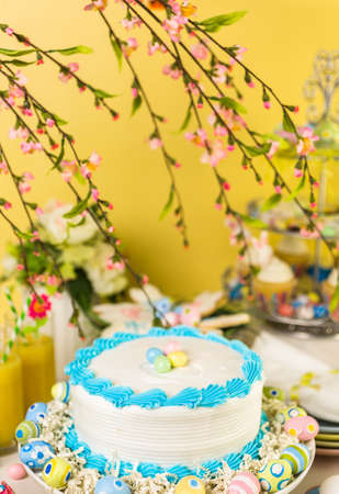 pastrie: Dessert table set with cake and cupcakes for Easter brunch.