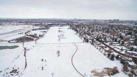 denver parks: Aerial view of school sport fields and residential area in the Winter. Stock Photo