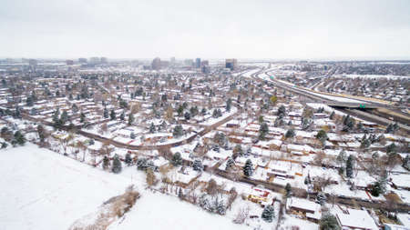 residential settlement: Aerial view of school sport fields and residential area in the Winter. Stock Photo