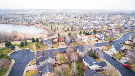 cul de sac: Aerial view of residential neighborhood at the beginning of snow storm.