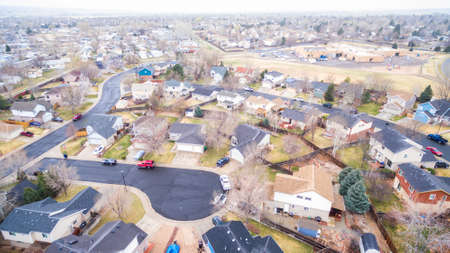 culdesac: Aerial view of residential neighborhood at the beginning of snow storm.