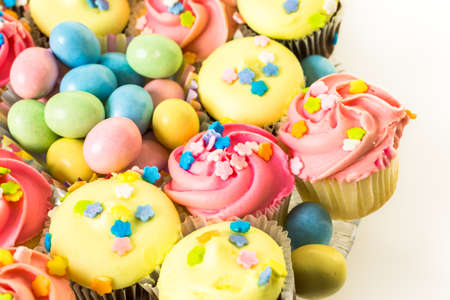 pastel color: Miniature Easter cupcakes with pastel color iving.