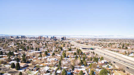 residential neighborhood: Aerial view of residential neighborhood with mountains in background. Stock Photo
