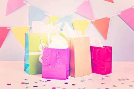 Gift bags at the kids Birthday party on the table. Stock Photo