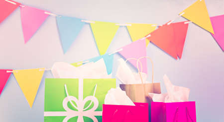 sweet pastry: Gift bags at the kids Birthday party on the table. Stock Photo
