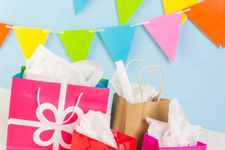 pastrie: Gift bags at the kids Birthday party on the table. Stock Photo