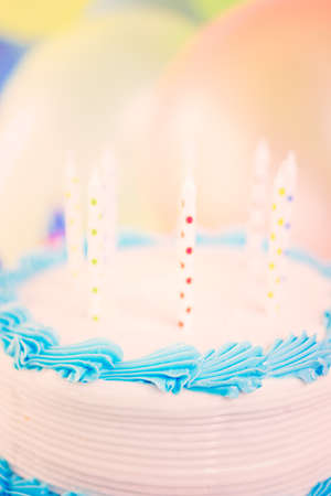 pastrie: Simple white Birthday cake with cake candles.