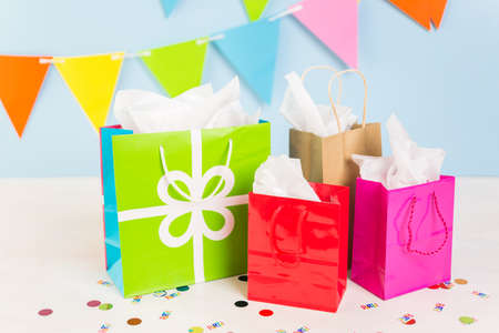 birthday presents: Gift bags at the kids Birthday party on the table. Stock Photo