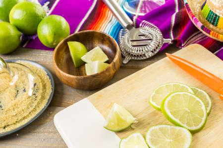 distilled alcohol: Classic lime margarita with garnish lime and turbinado sugar