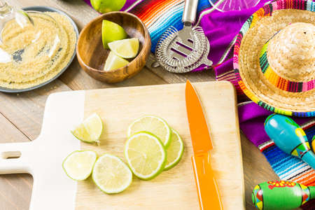 distilled alcohol: Classic lime margarita with garnish lime and turbinado sugar for Fiesta. Stock Photo