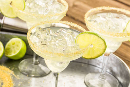 distilled alcohol: Classic lime margaritas on the rocks.