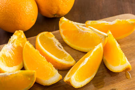 navel orange: Slices of organic navel orange on cutting board.