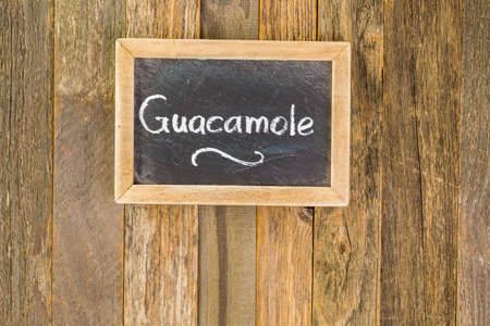 Chalk board with Guacamole white sign. Stock Photo