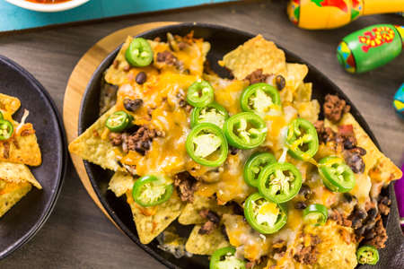 piperaceae: Claasic nachos with ground beef and fresh jalapeno chile peppers.