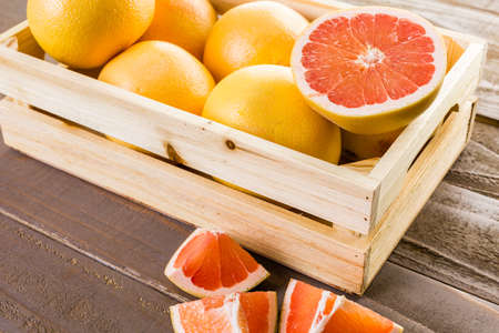 Fresh ryby red grapefruits in wood crate. Stock Photo