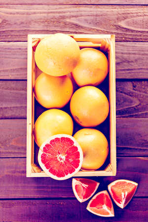 ruby red: Fresh ruby red grapefruits in wood crate.