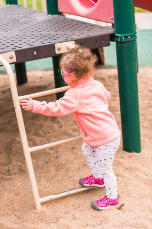 wallace: Toddler playing at the playground in urban park. Stock Photo