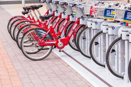 parked bikes: Denver, Colorado, USA-May 15, 2016. Red rental bikes parked at the Denver Union Staiton.