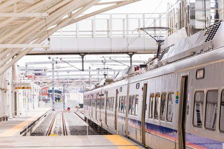railroad station platform: Denver, Colorado, USA-May 15, 2016. Light rail train to Denver International Airport at the Union Staion. Editorial