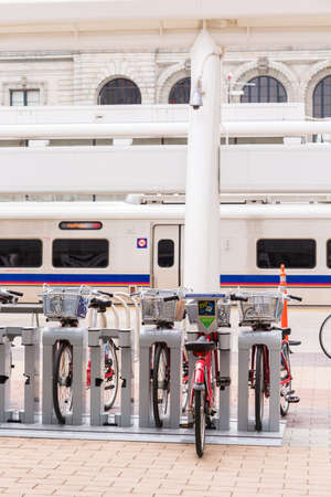 Denver, Colorado, USA-May 15, 2016. Red rental bikes parked at the Denver Union Staiton.