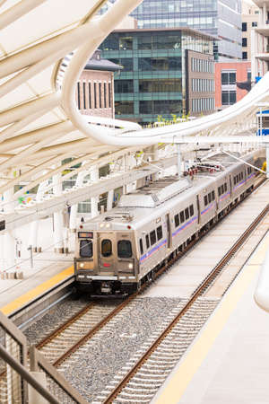 urban redevelopment: Denver, Colorado, USA-May 15, 2016. Light rail train to Denver International Airport at the Union Staion. Editorial