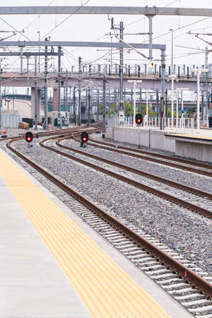 railroad station platform: Light rail train to Denver International Airport at the Union Staion. Stock Photo