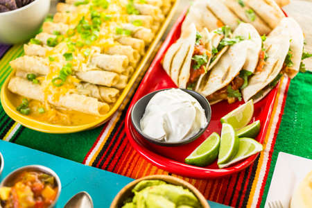 mild: Fiesta party buffet table with traditional Mexican food.