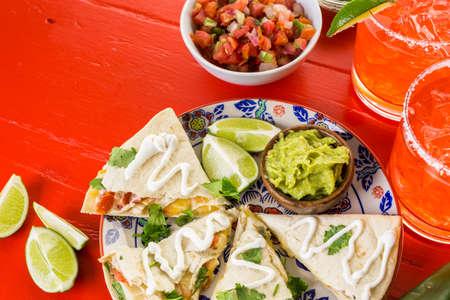 gallo: Sliced quesadilla filled with cheese, chicken and pico de gallo. Stock Photo