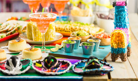 Fiesta party buffet table with traditional Mexican food.