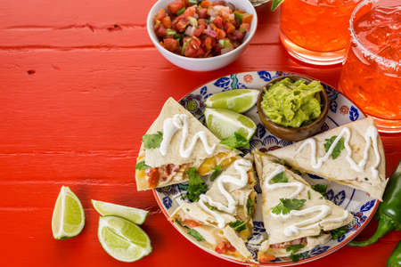 Sliced quesadilla filled with cheese, chicken and pico de gallo. Stock Photo