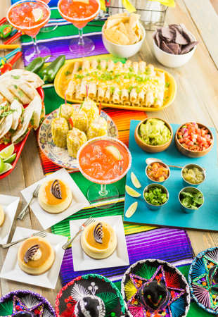 sweetened: Fiesta party buffet table with traditional Mexican food.