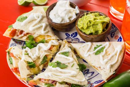 mild: Sliced quesadilla filled with cheese, chicken and pico de gallo. Stock Photo