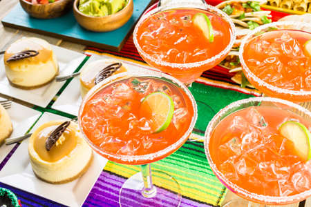 sweetened: Fiesta party buffet table with watermelon margaritas and other traditional Mexican food.