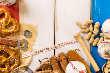 drink me: Close up of old worn baseball equipment on a wooden background.