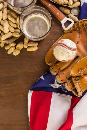 anthem: Close up of old worn baseball equipment on a wooden background.