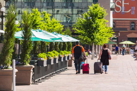 urban redevelopment: Travelers with suitcases at front of the Union Station in Denver, Colorado. Editorial