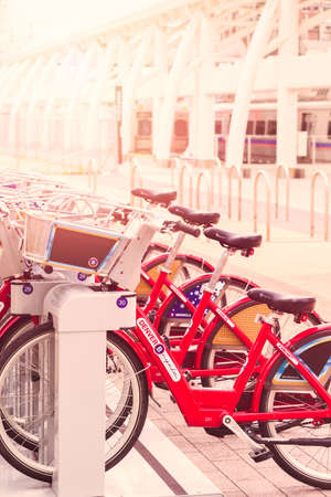 urban redevelopment: Denver, Colorado, USA-May 15, 2016. Red rental bikes parked at the Denver Union Staiton.