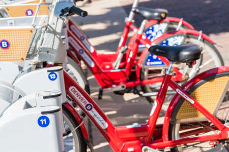 Denver, Colorado, USA-June 2, 2016. Red rental bikes near Union Station in Denver, Colorado.