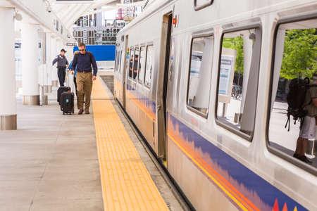 urban redevelopment: Denver, Colorado, USA-June 1, 2016. Commuter train from Denver Union Station to Denver International Airport.